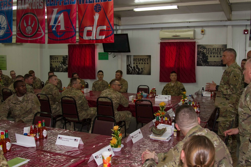Lt. Gen. Robert L. Caslen Jr., the superintendent of the United States Military Academy at West Point, speaks to graduates of West Point during lunch on Camp Arifjan, Kuwait, May 28, 2016. Caslen and members of the school's athletic department visited with graduates from West Point to get feedback from their time at the academy and how it affects the work they now do in the Army.