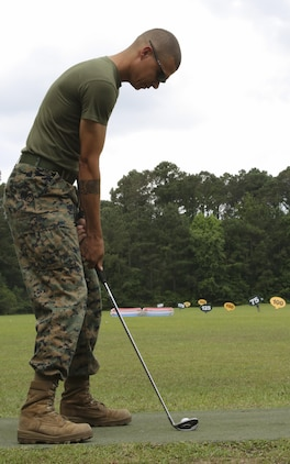 A Marine swings his club during the Stroke of Luck golf challenge aboard Marine Corps Air Station Beaufort May 18. The Marines are participating in the contest put together by Marine Corps Community Services for a chance to win a complimentary round of golf at the Legends Golf Course aboard Marine Corps Recruit Depot Parris Island. The Marines are with Marine Aircraft Group 31.