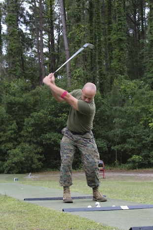Gunnery Sgt. Michael Haga swings a golf club aboard Marine Corps Air Station Beaufort May 18. Haga is participating in Stroke of Luck, a competition set up by Marine Corps Community Services, for a free round of golf at the Legends Golf Course aboard Marine Corps Recruit Depot Parris Island. Haga is with Marine Aircraft Group 31.
