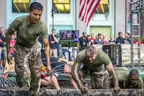 Marines compete in an obstacle course for a news program in New York City, May 28, 2016. Marines and sailors were in New York for Fleet Week to interact with the public, demonstrate capabilities and inform residents about America's sea services. Marine Corps photo by Cpl. Jonah Lovy