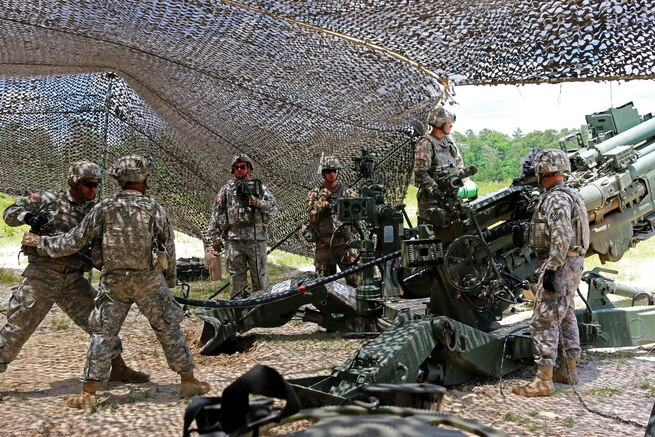 Soldiers load an M777 howitzer before a fire mission during an air attack team exercise at Fort Stewart, Ga., May 22, 2016. Army photo by Spc. Scott Lindblom