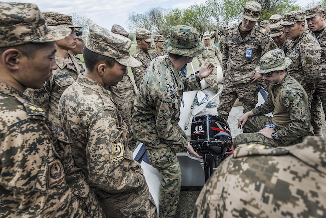 U.S. Marines teach Mongolian forces how to safely operate a combat rubberized raid craft during small boat training as part of Khaan Quest 2016 in Ulaanbataar, Mongolia, May 30, 2016. Navy photo by Petty Officer 3rd Class Markus Castaneda
