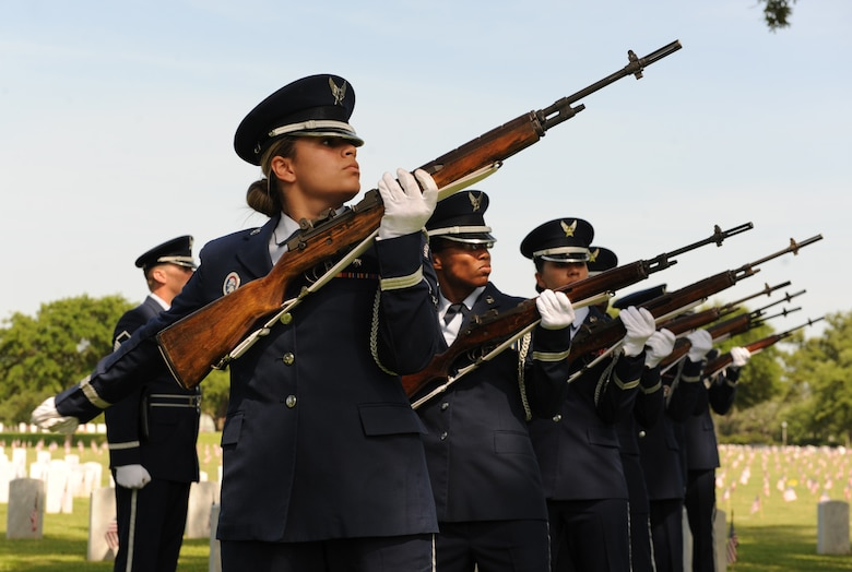 Members of the Keesler Honor Guard perform military honors during a Memorial Day Ceremony May 30, 2016, Biloxi, Miss. Local veterans, family members and Keesler Air Force Base personnel attended the event at the Biloxi National Cemetery to honor and remember the lives of fallen heroes of the U.S. military. (U.S. Air Force photo by Kemberly Groue)