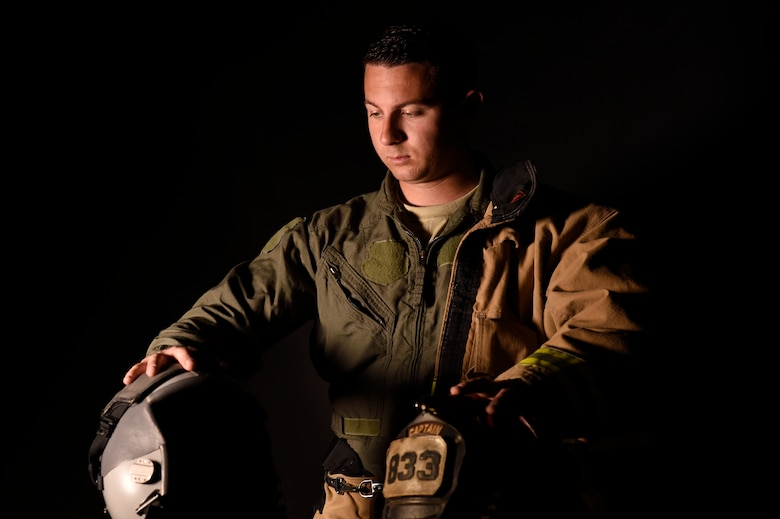 Staff Sgt. Garrett Christensen, 56th Civil Engineer Squadron logistics NCO in charge, prepares for his transition from firefighter to fighter pilot April 14, 2016 at Luke Air Force Base, Ariz. Christensen has been selected for Basic Officer Training School with the ultimate goal of becoming a fighter pilot. (U.S Air Force photo by Staff Sgt. Staci Miller)