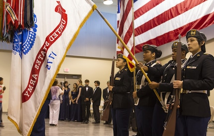 The Mountain View High School JROTC Color Guard present the Colors at a high school award ceremony that was held at the 83rd Military Police Company in El Paso, Texas on May 21, 2016. The ceremony recognized over 80 high school seniors for their decision to join the Army after school graduation.  (U.S. Army photo by Spc. Stephanie Ramirez)