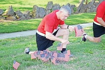 "Maj. Gen. Wayne W. Grigsby Jr., 1st Infantry Division and Fort Riley commanding general, places 39 American flags during Run for the Fallen May 7 at Riley's Conference Center to honor the Soldiers he lost during Operation Iraqi Freedom. ""I know the heartache of losing a Soldier in combat; I know the impact it has on the Soldiers and families left behind. I do not know what it's like to lose a son, a husband, an uncle or aunt — I can't imagine that feeling,"" Grigsby said."