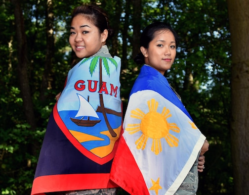Senior Airman Melissa Punzalan (left), 4th Aerospace Medicine Squadron deployment medicine technician, and Staff Sgt. Janna Matthews, 4th Medical Operations Squadron NCO in-charge of pediatrics, wrap themselves in their native flags of Guam and the Philippines, respectively, May 25, 2016, at Seymour Johnson Air Force Base, North Carolina. Both Airmen enjoy cooking their native cuisine and sharing it with friends and co-workers. (U.S. Air Force photo by Airman Shawna L. Keyes/Released)