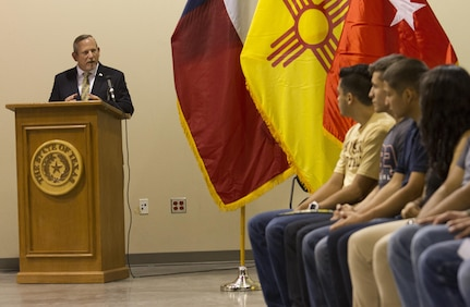 Ret. Command Sgt. Maj. Lance P. Lehr, the guest speaker at a high school award ceremony that was held at the 83rd Military Police Company in El Paso, Texas on May 21, 2016, addresses the graduating seniors about the importance of education both in the military and on the civilian side. The ceremony recognized over 80 high school seniors for their decision to join the Army after school graduation.  (U.S. Army photo by Spc. Stephanie Ramirez)