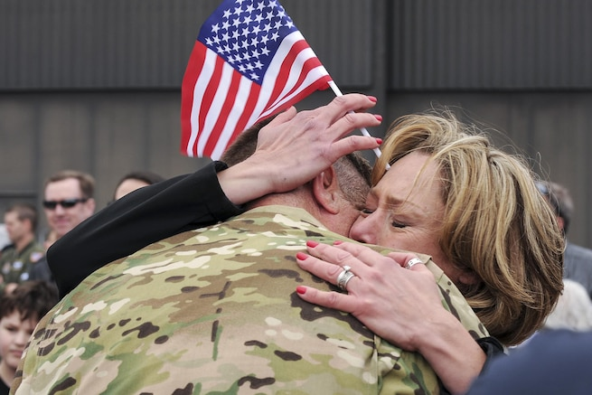 A spouse embraces her husband after he returned to Peterson Air Force Base, Colo., May 18, 2016, from a four-month deployment. About 150 Air Force reservists returned from Al Udeid Air Base, Qatar, where they supported Operations Freedom's Sentinel and Inherent Resolve. Air Force photo by Staff Sgt. Amber Sorsek