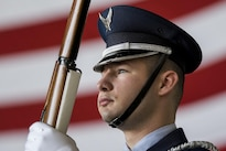 Airman 1st Class Andrew Des Marias stands at the position of port arms before the start of the 436th Maintenance Group change-of-command ceremony on Dover Air Force Base, Del., May 24, 2016. Des Marias is assigned to the 436th Aerial Port Squadron as a fleet service specialist when not performing honor guard duties. Air Force photo by Roland Balik