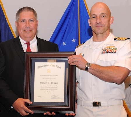 "DAHLGREN, Va. - Naval Surface Warfare Center Dahlgren Division (NSWCDD) Commanding Officer Capt. Brian Durant presents Michael Pompeii with the Navy Superior Civilian Service Award at the NSWCDD Annual Honor Awards ceremony on May 18, 2016. Pompeii was honored for his numerous substantial contributions to Naval Sea Systems Command as Chief Engineer for the NSWCDD Chemical, Biological, and Radiological (CBR) Defense Division. ""Mr. Pompeii has provided leadership to CBR Defense equipment designs, influenced CBR Defense policy and shipboard procedures, and increased the Navy's CBR Defense scientific, engineering, and test capabilities,"" according to the citation. ""He has challenged the status quo to define more realistic threats and has spearheaded several cost reduction initiatives that simultaneously achieved multi-million dollar savings for the Navy and increased fleet CBR Defense readiness."""