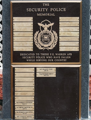 A memorial to security forces Airmen from the 90th Security Forces Group who have died in the line of duty, sits outside the SFG building on F.E. Warren Air Force Base, Wyo., May 30, 2016. The memorial had fallen into a state of tarnish and disrepair, and the 790th Missile Security Forces Squadron took charge of cleaning it up. (U.S. Air Force photo by Senior Airman Jason Wiese)