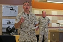 Sgt. Maj. Julio Meza, sergeant major, Marine Corps Installations - West, Marine Corps Base Camp Pendleton, speaks during a ceremony naming Camp Pendleton's 31 Area Edson Range Mess Hall the Maj. Gen. William Pendleton Thompson Hill Award winners for best full food service mess hall in the Marine Corps, May 31. 