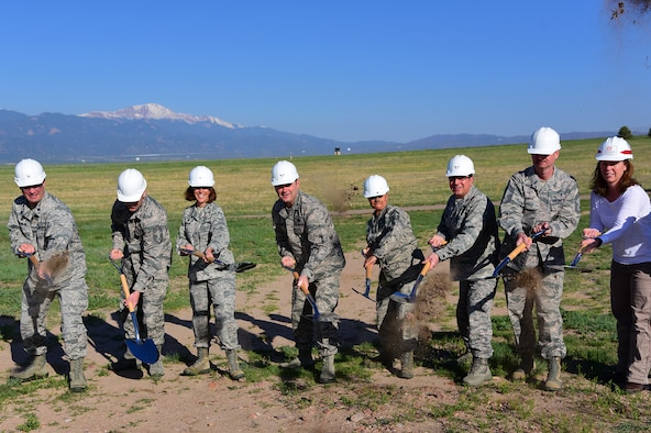 PETERSON AIR FORCE BASE Colo. – Col. Douglas Schiess, 21st Space Wing commander, and Chief Master Sgt. Idalia Peele, 21st Space Wing command chief, assist the 21st Medical Group leadership in breaking ground on where the new dental clinic will be on Peterson Air Force Base, Colo., May 25, 2016. The new clinic is expected to be completed in the fall of 2017. (U.S. Air Force photo by Staff Sgt. Amber Grimm)