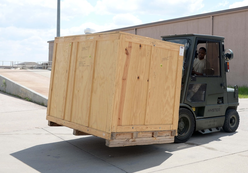 Airman Michael Butler, 28th Logistics Readiness Squadron receiving technician, uses a forklift to retrieve a crate at Ellsworth Air Force Base, S.D., May 17, 2016. The 28th LRS Traffic Management Office can receive shipments anywhere from 200 pounds to 18,000 pounds for one shipment. (U.S. Air Force photo by Airman 1st Class Sadie Colbert/Released)