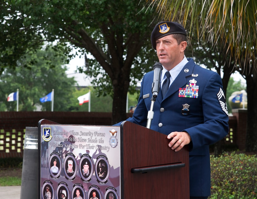 Chief Master Sergeant Robert Grimsley delivers comments as the guest speaker during the National Police Week ceremony May 20, 2016, at the base flag pole on Joint Base Charleston – Air Base, S.C.  In honor of Police Week, the 628th SFS collaborated with multiple base agencies to conduct various events to remember and celebrate their fallen brothers and sisters in law enforcement. (U.S. Air Force Photo/Airman 1st Class Haleigh Laverty)