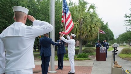 Joint Base Charleston Color Guard members lower the flag for Retreat during the National Police Week ceremony May 20, 2016, at the base flag pole on Joint Base Charleston – Air Base, S.C.  In honor of Police Week, the 628th Security Forces Squadron collaborated with multiple base agencies to conduct various events to remember and celebrate their fallen brothers and sisters in law enforcement. (U.S. Air Force Photo/Airman 1st Class Haleigh Laverty)