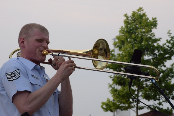 Airmen of Note trombonist Technical Sgt. Kevin Cerovich performs a solo during the U.S. Air Force Band's summer concert series kick off at National Harbor, Md. May 27, 2016. Through their performances the Airmen of Note and other Air Force bands help build, maintain and strengthen morale, while building public support and awareness of the Air Force and improving relations with communities both locally and globally. (U.S. Air Force photo/Courtesy)