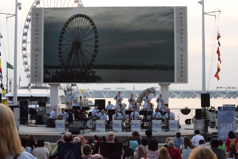 Airmen from the Airmen of Note perform during the U.S. Air Force Band's summer concert series kick off at National Harbor, Md. May 27, 2016. Throughout the months of June, July and August, the United States Air Force Band's various performing ensembles present free, outdoor concerts at historic venues around our nation's capital. (U.S. Air Force photo/Courtesy)