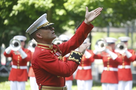 U.S. Marine Maj. Christopher E. Hall, commanding officer and director of The Commandant's Own, conducts the Drum and Bugle Corps at the 9/11 Memorial during Fleet Week New York, May 29, 2016. U.S. Marines and sailors are in New York to interact with the public, demonstrate capabilities, and teach the people of New York about America's sea service. (U.S. Marine Corps Photo by Lance Cpl. Jimmy J. Vertus Combat Camera/Released).