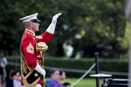 Master Gunnery Sgt. Keith Martinez, drum major, United States Marine Drum and Bugle Corps, performs during the Sunset Parade at the Marine Corps War Memorial, Arlington, Va., May 31, 2016. The guest of honor for the parade was Rear Adm. Valter Zappellini, Dean of Corps of Foreign Naval Attachés, Italian Navy, and the hosting official was Brigadier Gen. Michael S. Groen, director of Intelligence, J-2. (Official Marine Corps photo by Cpl. Chi Nguyen/Released)