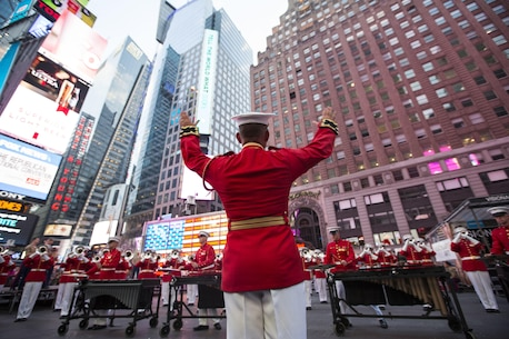 U.S. Marine Maj. Christopher Hall, the commanding officer and director of The Commandant's Own, directs the Drum and Bugle Corps during a performance at Times Square in New York during Fleet Week, May 28, 2016. Marines, sailors and Coast Guardsmen are in New York to interact with the public, demonstrate capabilities and teach the people of New York about America's sea services. (U.S. Marine Corps photo by Cpl. Todd F. Michalek/Released)