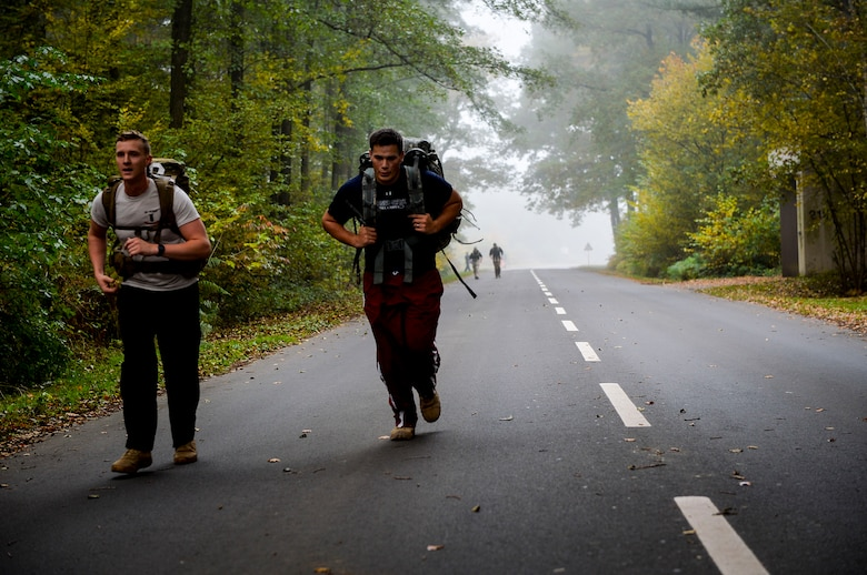 Participants in the 786th Civil Engineer Squadron's explosive ordnance disposal ruck and run complete their final lap at Ramstein Air Base, Germany, Oct. 28, 2016. Although 786th CES's EOD flight conducts ruck marches every month, the October ruck and run was a special Halloween-themed event designed to support the Combined Federal Campaign. (U.S. Air Force photo by Airman 1st Class Joshua Magbanua)