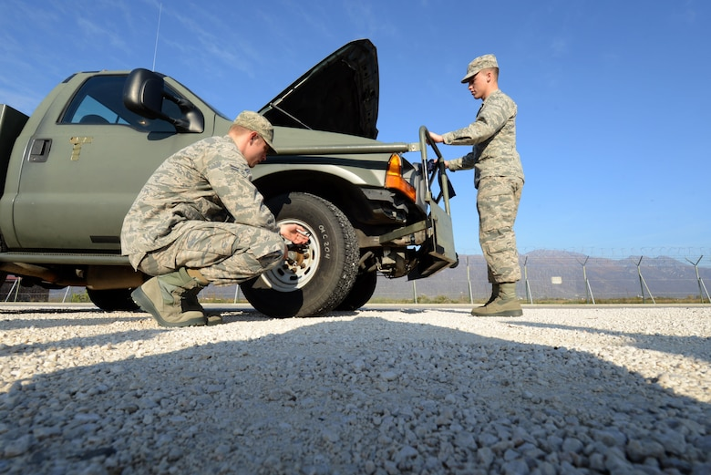 Airmen 1st Class Toivo Tamm and Jesse Scheidel, 31st Logistics Readiness Squadron mission generation vehicular equipment maintenance technicians, perform an annual vehicle safety inspection on a government owned vehicle at Aviano Air Base, Italy on Oct. 31, 2016. Routine inspections can help reduce GOV repair time through early detection and remediation. (U.S. Air Force photo by Staff Sgt. Andrew Satran/Released)