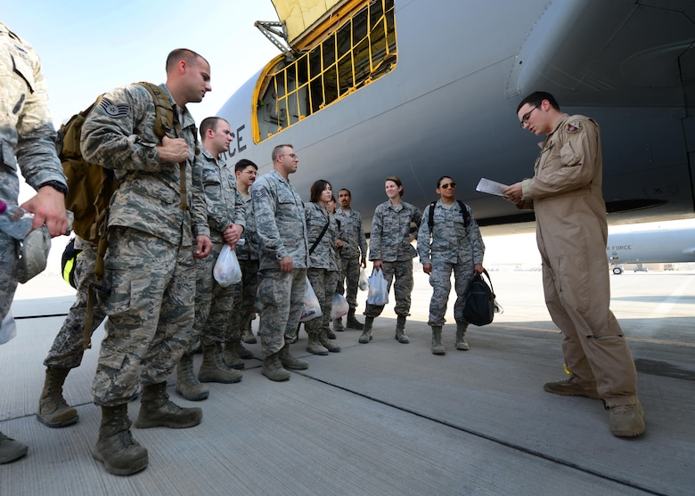An Airman from the 340th Expeditionary Refueling Squadron gives a briefing to members of the 379th Air Expeditionary Wing at Al Udeid Air Base, Qatar Oct. 27, 2016. The members were part of an incentive flight onboard a KC-135 Stratotanker during which they witnessed the refueling of F-16 Fighting Falcons. (U.S. Air Force photo by Senior Airman Miles Wilson)