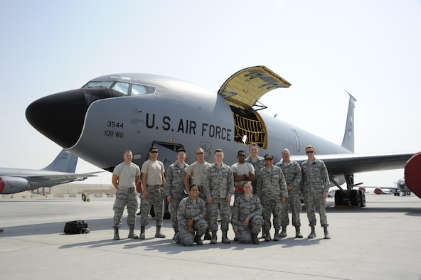 379th Air Expeditionary Wing Airmen pose for a group photo prior to taking an incentive flight at Al Udeid Air Base Oct. 27, 2016. The Airmen learned about the KC-135 Stratotanker during a tour organized in appreciation of the 379th Air Expeditionary Wing Airman's dedication to the U.S. Air Force mission. (U.S. Air Force Photo by Senior Airman Cynthia A. Innocenti)