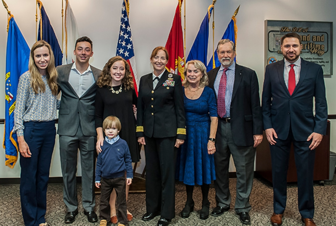 Rear Adm. Michelle Skubic, commander, DLA Land and Maritime, poses with her family after taking over command of the organization Oct. 31 at Defense Supply Center Columbus.