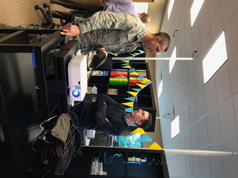 AFRL software engineer Kevin Porter, shows first Lieutenant Kyle Matissek, one of the many desktop stations offered at the AFRL Maker Hub during its grand opening held on October 27, 2016. (U.S. Air Force photo/Stacey Geiger)