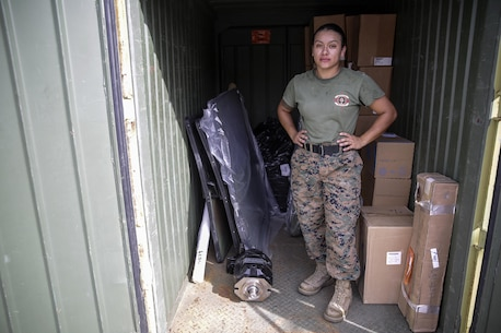 Sgt. Angie Novoa, a warehouse chief with Special Purpose Marine Air-Ground Task Force Crisis Response-Africa, stands in a Quadcon container on Naval Air Station Sigonella, Italy, Oct. 26, 2016.  Novoa was awarded the non-commissioned officer of the quarter for her exemplary work in and out of the supply shop while deployed with SPMAGTF-CR-AF.  (U.S. Marine Corps photo by Cpl. Alexander Mitchell/released)