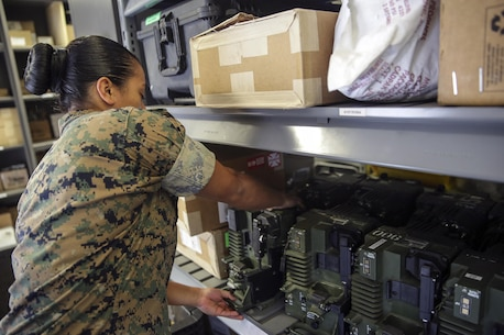 Sgt. Angie Novoa, a warehouse chief with Special Purpose Marine Air-Ground Task Force Crisis Response-Africa, organizes a shelf in her warehouse on Naval Air Station Sigonella, Italy, Oct. 28, 2016.  Novoa was awarded the non-commissioned officer of the quarter for her exemplary work in and out of the supply shop while deployed with SPMAGTF-CR-AF.  (U.S. Marine Corps photo by Cpl. Alexander Mitchell/released)