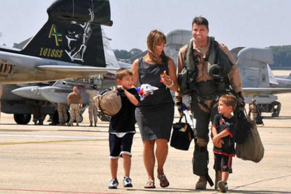 U.S. Navy Cmdr. Michael Esper walks across the flight line with his wife and children during a homecoming celebration at Joint Base Andrews Naval Air Facility Washington in Maryland, Sept. 7, 2010. DoD photo by Petty Officer 2nd Class Clifford H. Davis
