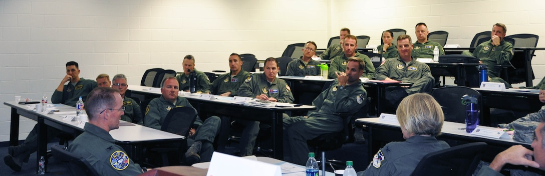 Col. Roger Suro, 340th Flying Training Group commander, briefs commanders at the Group's annual fall commanders summit at Joint Base San Antonio-Randolph, Texas. Photo by Janis El Shabazz