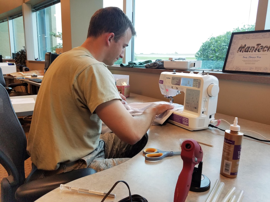 Capt.  Lance Wilhelm creates a prototype design for a flexible, conformal body armor vest using the computerized sewing equipment available in the AFRL Maker Hub. The prototype will allow the AFRL research team to evaluate different materials to better understand the project design needs.  (U.S. Air Force photo/Holly Jordan)