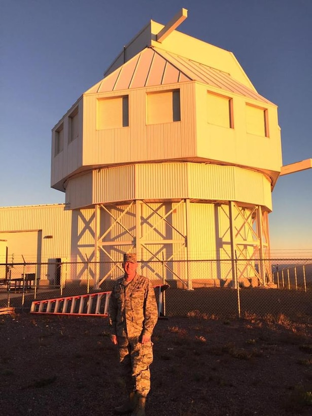 Col. Troy Endicott, 21st Operations Group commander, stands in front of the Space Surveillance Telescope as the sun sets at White Sands Missile Range, N.M., Oct 18, 2016. The SST brings many new capabilities to deep space observations, including an extra wide field-of-view and unrivaled speed. (Courtesy photo)