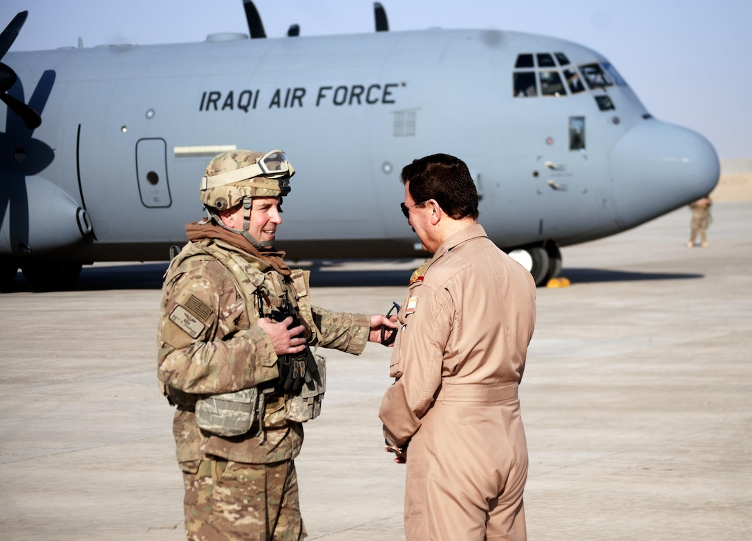 U.S. Air Force Col. Rhett Champagne, left, commander, 821st Crisis Response Group, speaks with the chief of staff of the Iraqi Air Force upon the landing of his C-130J Super Hercules at Qayyarah West Airfield, Iraq, Oct. 30, 2016. This was the first time a fixed wing aircraft from the Iraqi security forces landed at Qayyarah West Airfield since the base was occupied by Islamic State of Iraq and the Levant in 2014. Coalition forces reconstructed the airfield as part of their effort to assist the Iraqi security forces as the seize territory from ISIL. The Qayyarah West Airfield serves as a logistics hub for ongoing operations in northern Iraq. (U.S. Army photo by 1st Lt. Daniel Johnson)