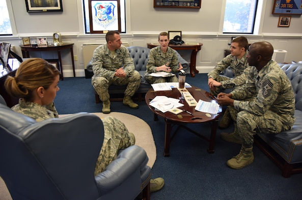 Staff Sgt. Eric Dasher, 335th Training Squadron precision measurement and equipment laboratory basic course instructor, attends a meeting with 81st Training Wing leadership at the 81st TRW headquarters building Nov. 1, 2016, on Keesler Air Force Base, Miss. Dasher participated in the new Command Chief for a Day program which highlights outstanding enlisted performers from around the wing. Each Airman selected for the program will spend the day shadowing Clark to learn what it takes to be a command chief. (U.S. Air Force photo by Kemberly Groue/Released)