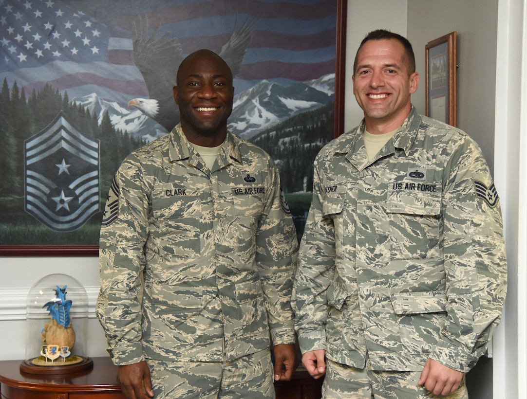 Chief Master Sgt. Vegas Clark, 81st Training Wing command chief, and Staff Sgt. Eric Dasher, 335th Training Squadron precision measurement and equipment laboratory basic course instructor, pose for a photo at the 81st TRW headquarters building Nov. 1, 2016, on Keesler Air Force Base, Miss. Dasher participated in the new Command Chief for a Day program which highlights outstanding enlisted performers from around the wing. Each Airman selected for the program will spend the day shadowing Clark to learn what it takes to be a command chief. (U.S. Air Force photo by Kemberly Groue/Released)