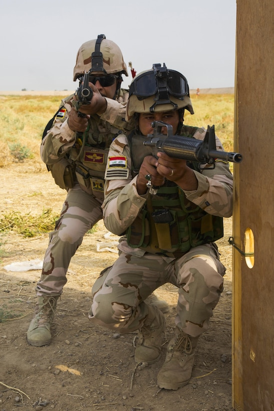 Iraqi soldiers attending Iraqi Noncommissioned Officer Academy clear a corner during urban-combat training at Camp Taji, Iraq, Oct. 22, 2016. This training is critical to enabling the Iraqi security forces to counter ISIL as they work to regain territory from the terrorist group. (U.S. Army photo by Spc. Craig Jensen)