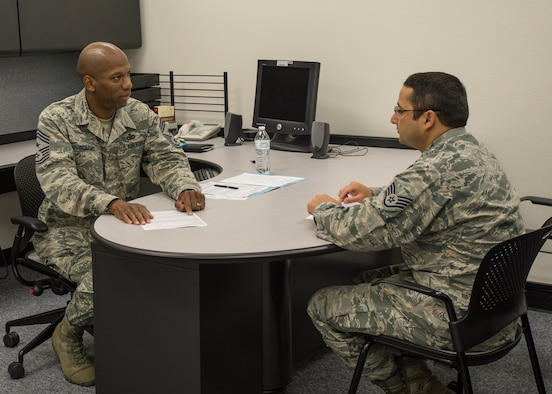 Chief Master Sgt. Todd Simmons (left), 412th Test Wing command chief, talks with Staff Sgt. Noah Clifton, 31st Test and Evaluation Squadron, at the Desert Mall Oct. 21. The chief led a team of chief master sergeants during the Chief Speed Review. Fifty Airmen rotated through five chiefs for five minutes each to receive career guidance and discuss future opportunities within the Air Force. (U.S. Air Force photo by John Perry)