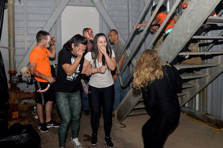 Volunteers scare participants in the haunted house at the Louis F. Garland Department of Defense Fire Academy training pad during Ghoulfellow on Goodfellow Air Force Base, Texas, Oct. 28, 2016. Volunteers from various squadrons on base dressed up in costumes to play roles in the haunted house. (U.S. Air Force photo by Airman 1st Class Randall Moose/Released)