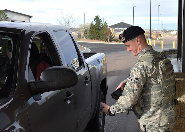 Airman 1st Class Dylan Kerns, 341st Security Forces Squadron member, checks identification cards for incoming visitors through the 10th Avenue North Access Gate at Malmstrom Air Force Base, Mont., Nov. 1, 2016.  The gate will serve as the permanent 24-hour main access gate starting on Nov. 5. (U.S. Air Force photo/Jason Heavner)