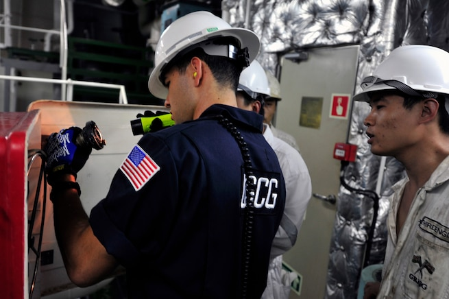 A lead marine inspector from Coast Guard Sector Delaware Bay, in Philadelphia, inspects the Hong Kong-flagged bulk carrier at the Balzano Marine Terminal in Camden, N.J. The Coast Guard regularly inspects domestic and foreign vessels to facilitate secure maritime trade. (U.S. Coast Guard photo by Petty Officer 2nd Class Cynthia Oldham)