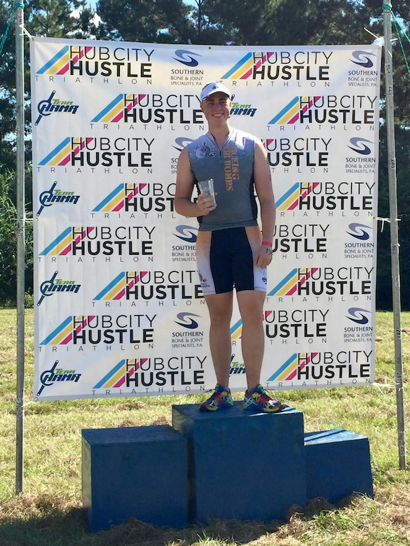 U.S. Air Force Staff Sgt. Jason Parker, 325th Aerospace Medical Squadron medical service craftsman, smiles after completing the Hub City Hustle Triathlon hosted in Hattiesburg, Miss., Oct. 8, 2014. Parker won the military division of the triathlon. He has run in triathlons for three years and has discovered a correlation with the difficulty of the activity and accomplishing things in his personal and professional life. (Courtesy photo)