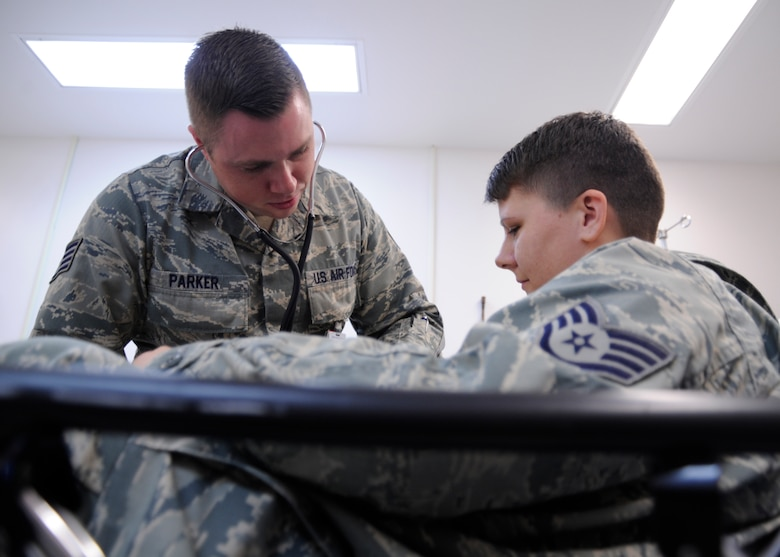 U.S. Air Force Staff Sgt. Jason Parker, 325th Aerospace Medical Squadron medical service craftsman, checks the pulse of a coworker during a training exercise in Tyndall Air Force Base medical clinic, Fla., Oct. 25, 2016. Parker was selected as an outstanding performer in the 325th AMDS by his leadership. (U.S. Air Force photo by Senior Airman Solomon Cook/Released)