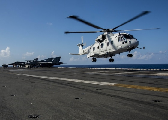 A Japanese MCH-101 airborne mine countermeasures helicopter carrying Vice Adm. Hiroshi Yamamura, commander, Fleet Escort Force, and Rear Adm. Tatsuya Fukuda, commander, Escort Flotilla 4, lands on the flight deck of the Navy's only forward-deployed aircraft carrier, USS Ronald Reagan (CVN 76) for the start of Exercise Keen Sword 2017 (KS17). Ronald Reagan is participating in Exercise KS17, a joint, bilateral field-training exercise involving U.S. military and Japan Self-Defense Force personnel designed to increase the combat readiness and interoperability of the Japan-U.S. alliance.