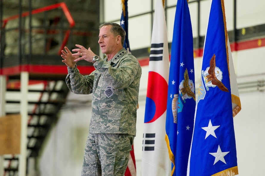 Air Force Chief of Staff Gen. David L. Goldfein speaks with Team Osan during an all-call on Osan Air Base, Republic of Korea, Oct. 31 2016. While visiting the base, Goldfein shared his priorities of revitalizing squadrons, strengthening joint leaders and teams, and multi-domain command and control. (U.S. Air Force photo by Staff Sgt. Jonathan Steffen)